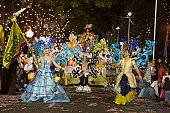 Dancers and float on Carnival parade route.
