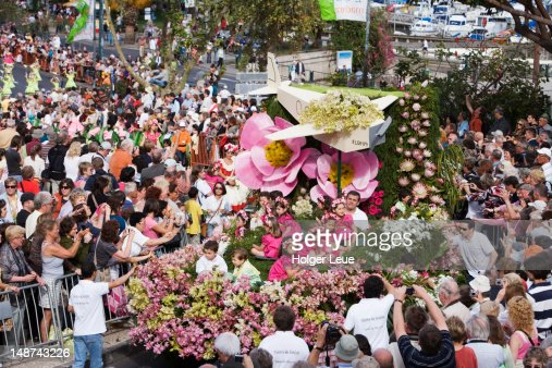 Dancers and floral float at Madeira Flower Festival parade.