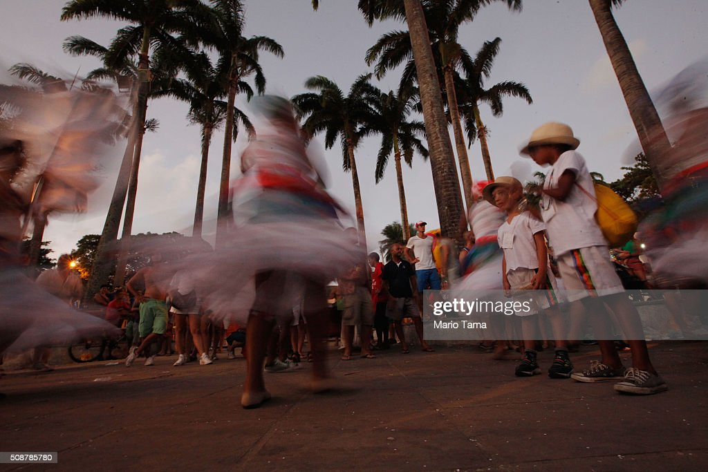 Dancers are blurred in a long exposure during Carnival celebrations on February 6, 2016 in Olinda, Pernambuco state, Brazil. Revellers in Olinda and sister city Recife are gathering for various concerts and street parades during Carnival in spite of fears over the Zika virus.