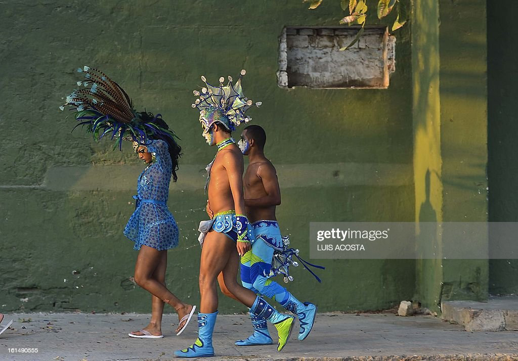 Dancers are pictured after taking part in the third day of carnival in Barranquilla, Colombia, on February 11, 2013. Barranquilla's Carnival, a tradition created by locals at the end of the 19th century as a response and to parody the celebration held by European immigrants and aristocracy, was declared a 'Masterpiece of Oral and Intangible Heritage of Humanity' by the UNESCO in 2003. AFP PHOTO/Luis Acosta