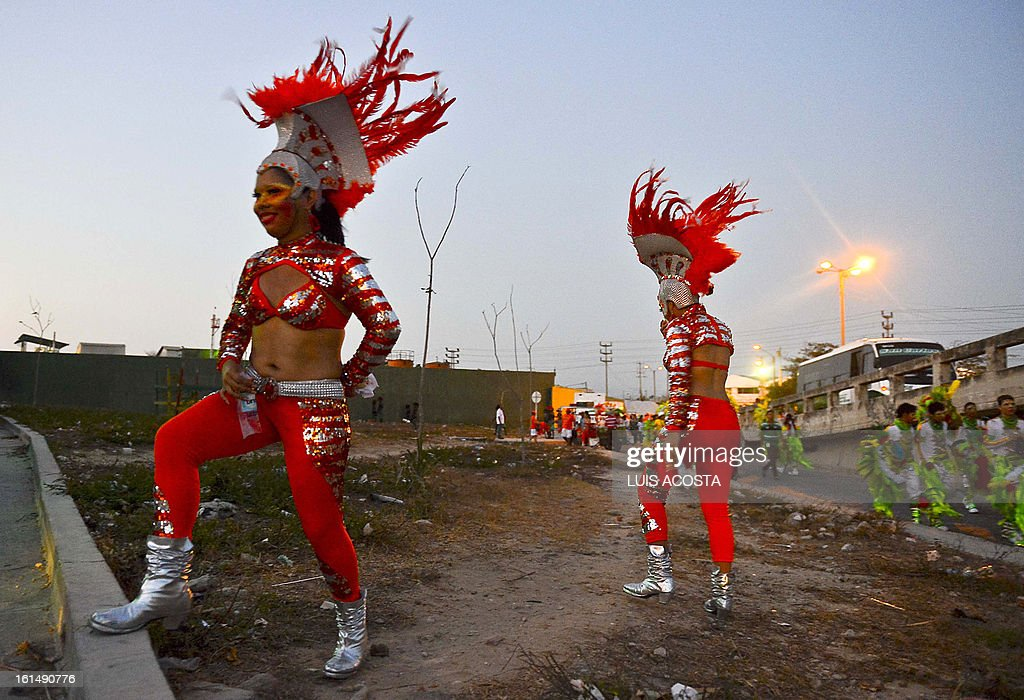 Dancers are seen after taking part in the third day of carnival in Barranquilla, Colombia, on February 11, 2013. Barranquilla's Carnival, a tradition created by locals at the end of the 19th century as a response and to parody the celebration held by European immigrants and aristocracy, was declared a 'Masterpiece of Oral and Intangible Heritage of Humanity' by the UNESCO in 2003. AFP PHOTO/Luis Acosta