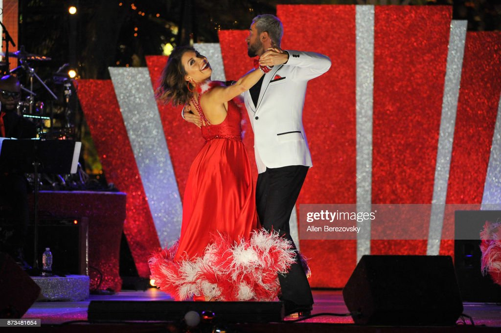 Dancers Artem Chigvintsev and Jenna Johnson perform onstage during A California Christmas at The Grove Presented by Citi on November 12, 2017 in Los Angeles, California.