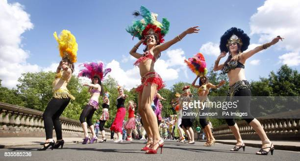 Dancers as The West End Festival gets under way with 'Scotland's Mardi Gras' where over one thousand costumed performers and bands paraded in...