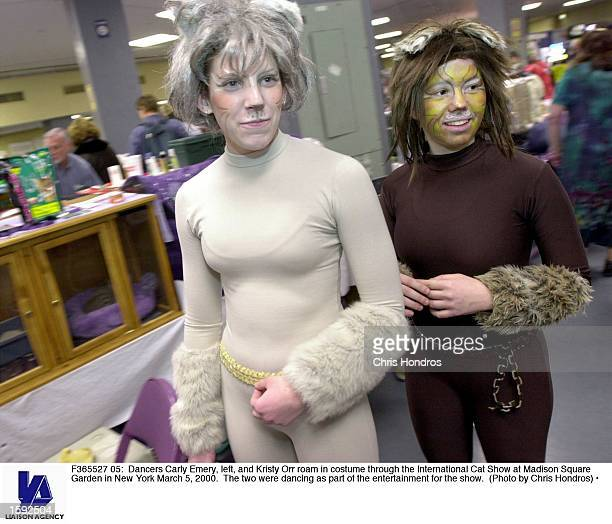 Dancers Carly Emery left and Kristy Orr roam in costume through the International Cat Show at Madison Square Garden in New York March 5 2000 The two...