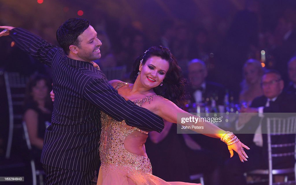 Dancers Darren Bennett and Lilia Kopylova perform a ballroom dancing routine as part of Dancing with United, in aid of the Manchester United Foundation, at Old Trafford on March 7, 2013 in Manchester, England.