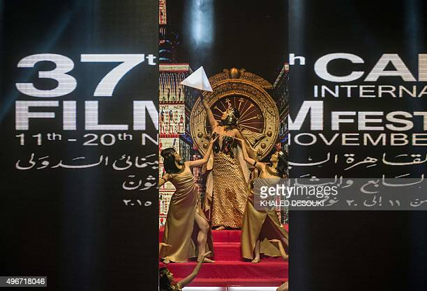 Dancers dressed as Egyptian pharaohs perform on the stage during the opening ceremony of the 37th Cairo International Film Festival at the Cairo...