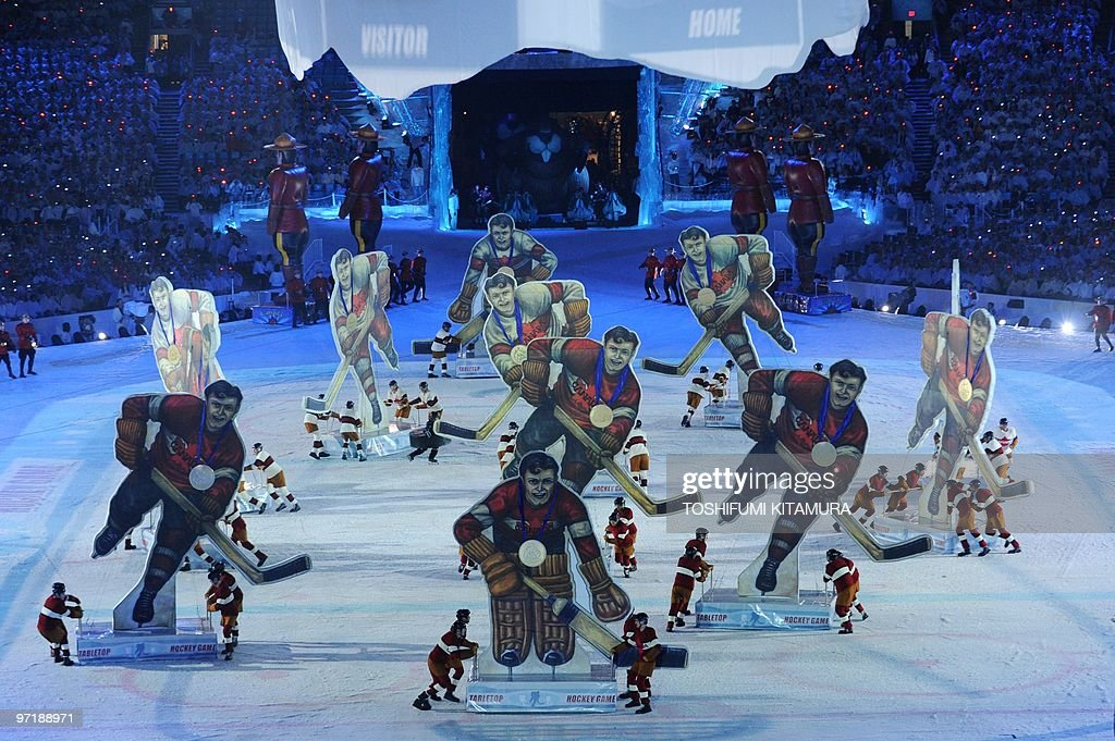 Dancers dressed as hockey players perform during the closing ceremony at the BC Place in Vancouver, on the last day of the 2010 Winter Olympics on February 28, 2010.