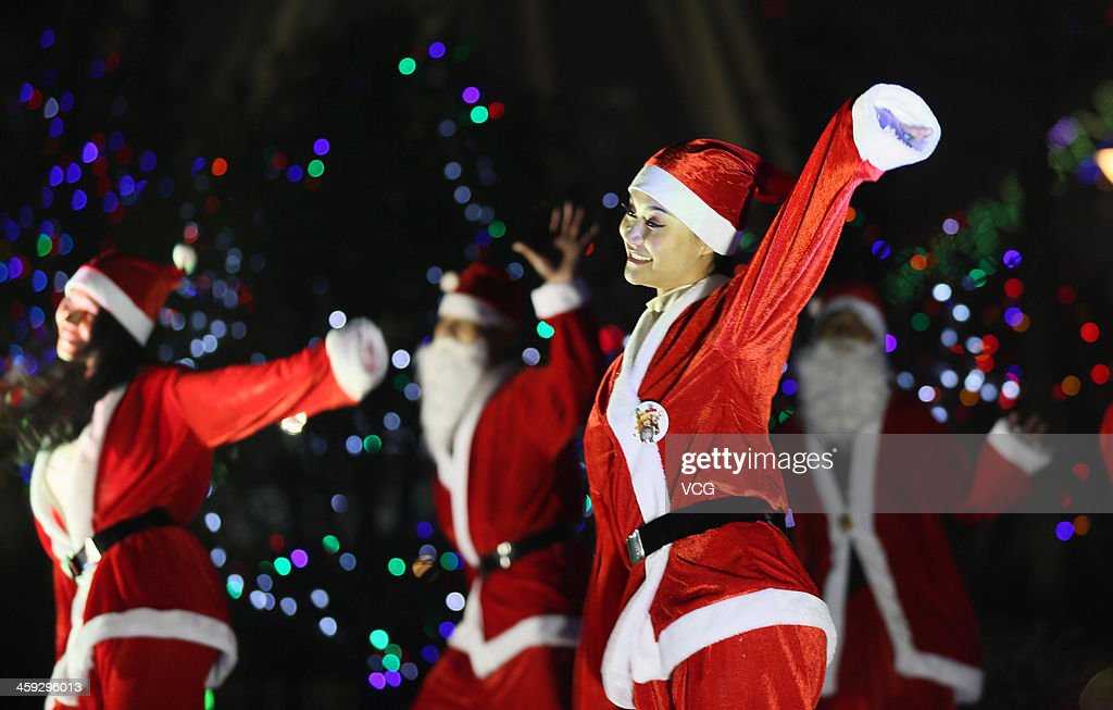 Dancers dressed as Santa Claus attend a celebration for the Christmas Eve on December 24, 2013 in Nantong, China.