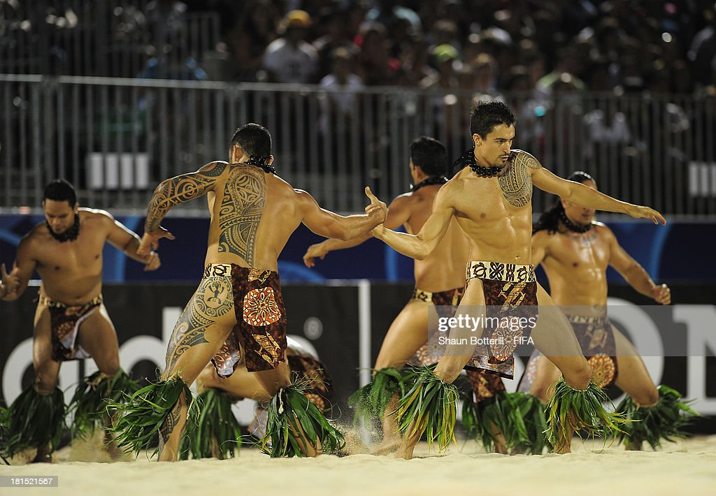 Dancers entertain the crowd during the FIFA Beach Soccer World Cup Tahiti 2013 Group A match between USA and Tahiti at the Tahua To'ata stadium on September 21, 2013 in Papeete, French Polynesia.