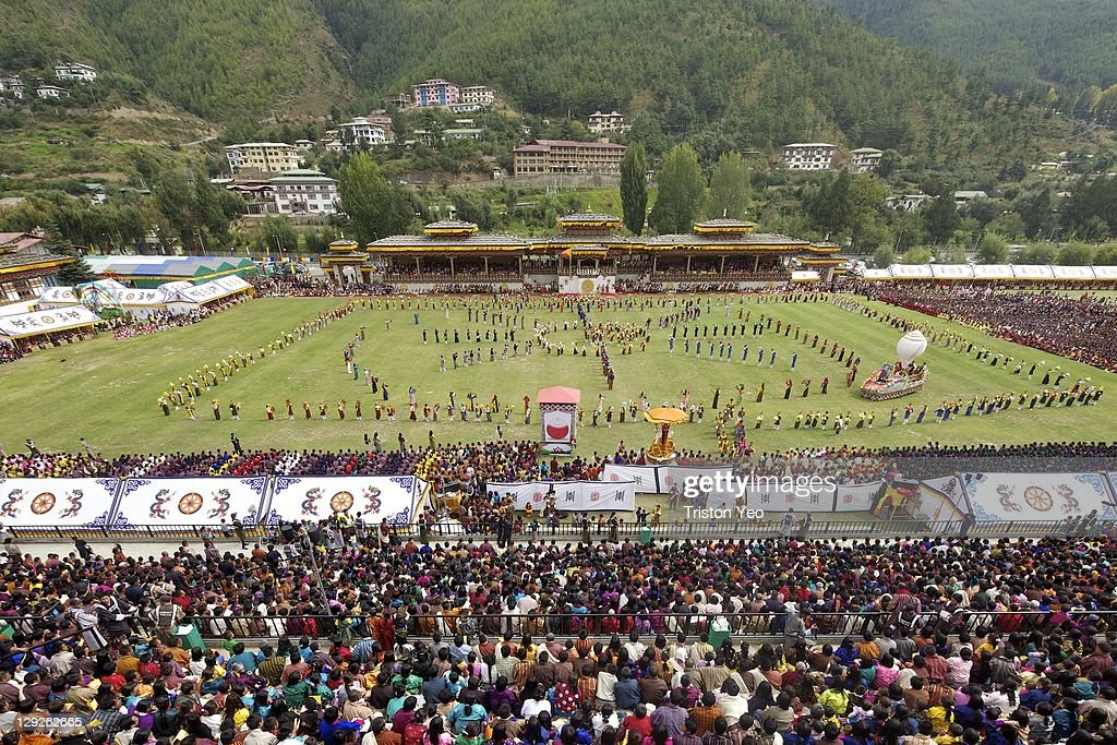Dancers entertain the guests at the wedding celebration of The Royal Couple, His Majesty, King Jigme Khesar Namgyel Wangchuck and Her Majesty Queen Ashi Jetsun Pema Wangchuck at the Chang Lime Thang stadium on October 15, 2011 in Thimphu, Bhutan. In this final day of wedding celebrations for the royal wedding, more than 50,000 people turned up at the stadium with about 500 performers to entertain the guests. (Photo by Triston Yeo/Getty Images