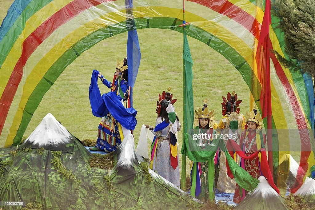 Dancers entertain the guests at the wedding celebration of The Royal Couple, His Majesty, King Jigme Khesar Namgyel Wangchuck and Her Majesty Queen Ashi Jetsun Pema Wangchuck at the Chang Lime Thang stadium on October 15, 2011 in Thimphu, Bhutan. In this final day of wedding celebrations for the royal wedding, more than 50,000 people turned up at the stadium with about 500 performers to entertain the guests.
