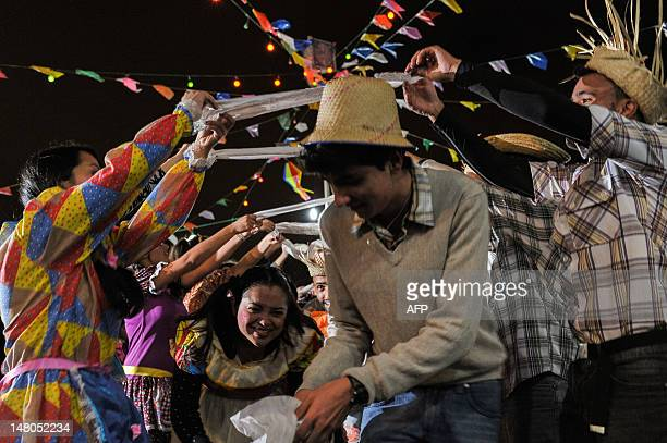 Dancers fancy dressed with country costumes perform traditional folk dance Quadrilha at Calvario Church in Sao Paulo Brazil on July 8 2012 The...