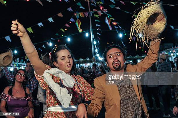 Dancers fancy dressed with typical costumes perform traditional folk dance Quadrilha at Calvario Church in Sao Paulo Brazil on July 8 2012 The...