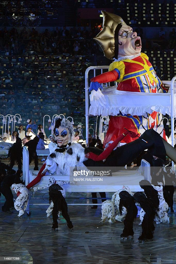 Dancers feature a scene of 101 Dalmatians as they perform during the opening ceremony of the London 2012 Olympic Games on July 27, 2012 at the Olympic stadium in London. AFP PHOTO / MARK RALSTON