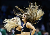 Dancers for the Charlotte Hornets in action during their game against the Boston Celtics at Time Warner Cable Arena on December 12 2015 in Charlotte...