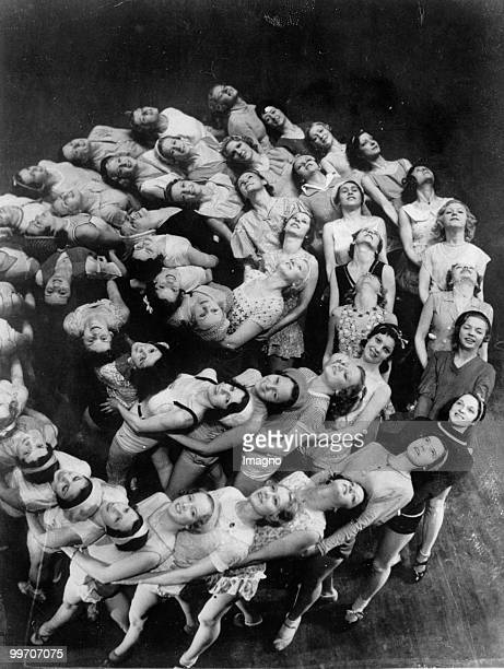 Dancers forming a human rosebud as they rehearse their dances which they performed at the opening of the Roxy Music Hall Photograph Around 1935 Photo...