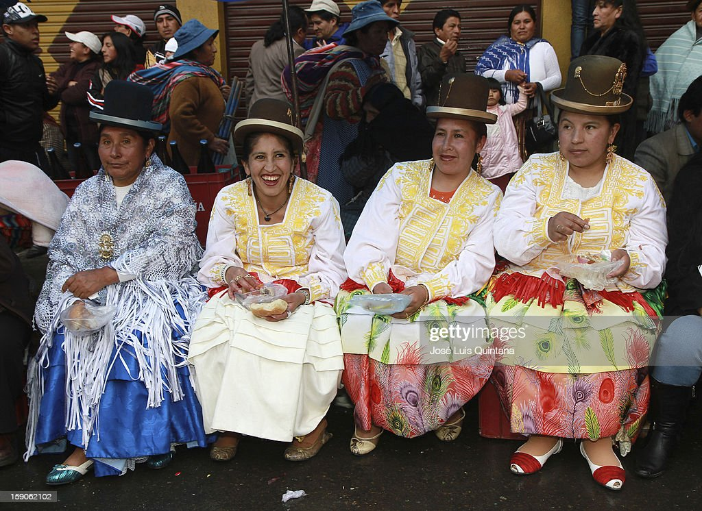 Dancers from a folkloric troupe eat sausages in a peddler, after participating in the traditional festibal 'Desenterrando el Pepino' (unearthing the Cucumber) at the General Cemetery duting the carnival celebrations 2013, on January 06, 2013, in La Paz, Bolivia.