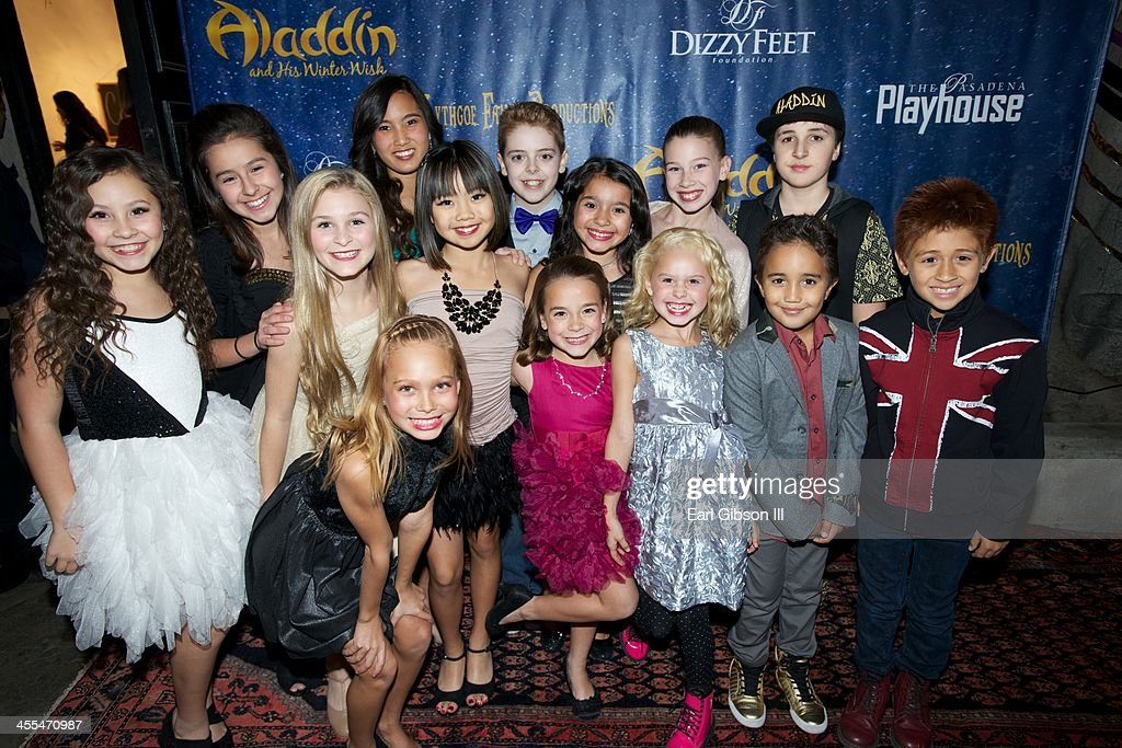 Dancers from 'Aladdin And His Winter Wish' pose for a photo opening night of 'Aladdin And His Winter Wish' at Pasadena Playhouse on December 11, 2013 in Pasadena, California.