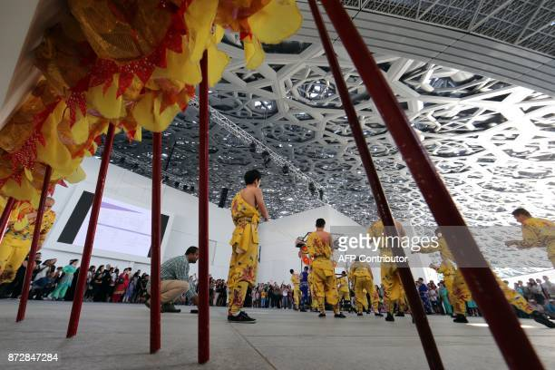 Dancers from Korean musical ensemble 'Baraji' perform during the opening of the Louvre Abu Dhabi Museum on November 11 2017 on Saadiyat island in the...