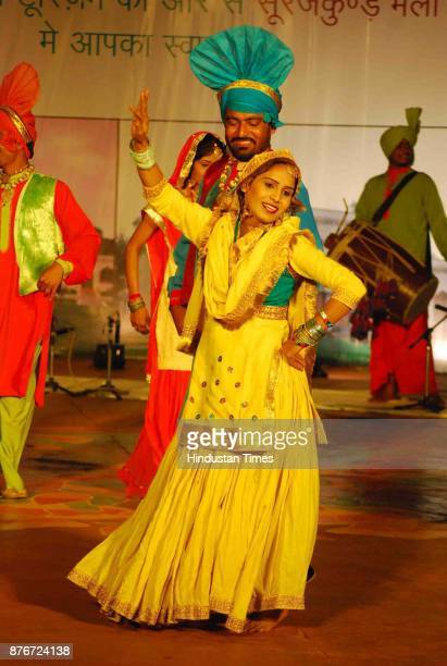 Dancers from Punjab perform during Surajkund Crafts Mela organised at Surajkund in Faridabad The 15day annual event which is observing its...