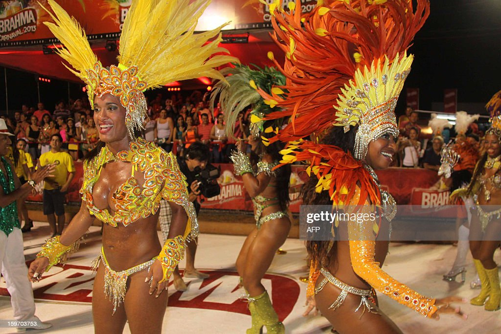 Dancers from San Clemente samba school in Rio de Janeiro, Brazil take part at the carnival in Encarncion, 375 km south of Asuncion on January 18, 2013. AFP PHOTO / STR / AFP / NORBERTO DUARTE