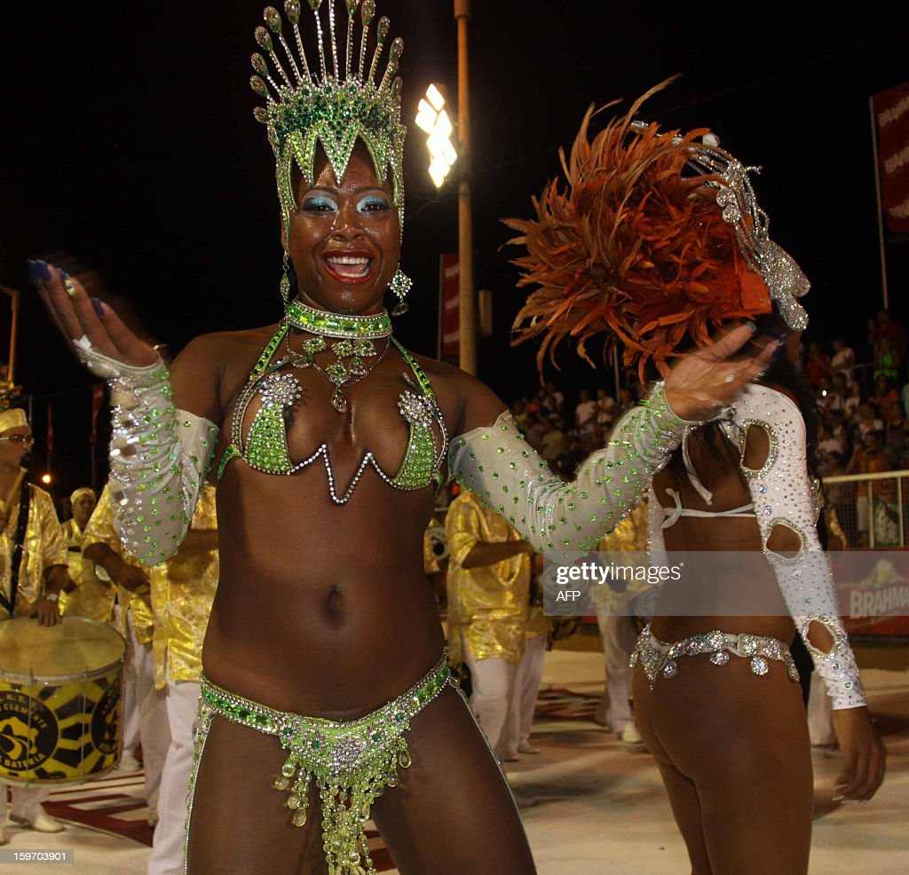 Dancers from San Clemente samba school in Rio de Janeiro, Brazil take part at the carnival in Encarncion, 375 km south of Asuncion on January 18, 2013.