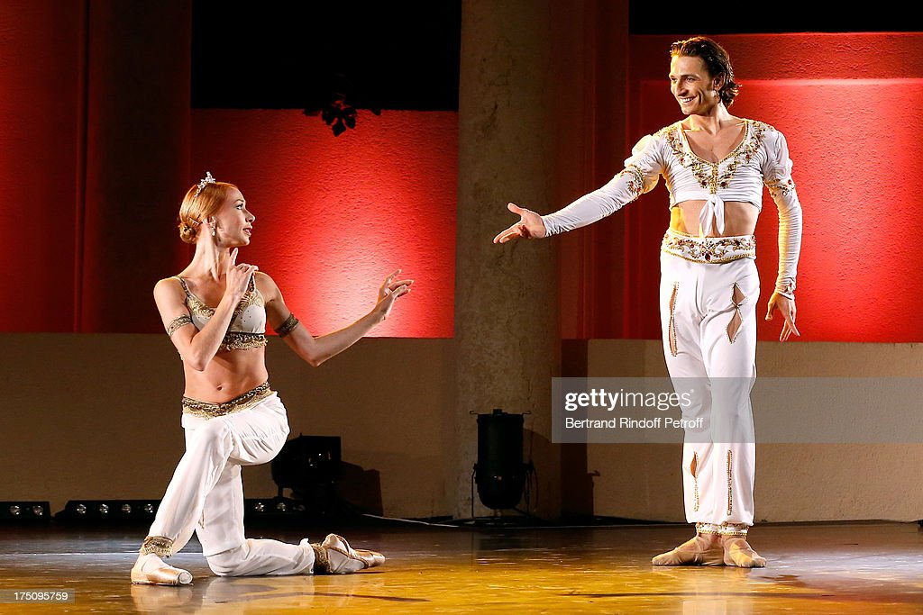 Dancers from StaatsBallet of Berlin Iana Salenko and Dinu Tamaziacaru perform at 'Stars under Stars' at 29th Ramatuelle Festival on July 31, 2013 in Ramatuelle, France.