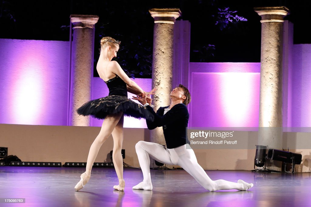 Dancers from StaatsBallet of Vienne Olga Esina and Robert Gabdullin perform at 'Stars under Stars' at 29th Ramatuelle Festival on July 31, 2013 in Ramatuelle, France.