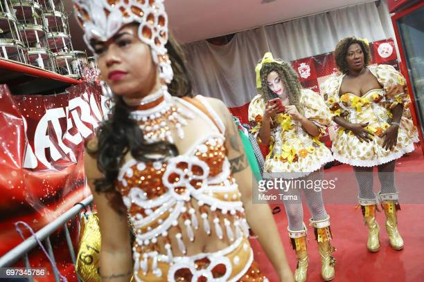 Dancers from the Grande Rio samba school prepare to perform during a traditional Festas Juninas party at the Salgueiro samba school on June 18 2017...