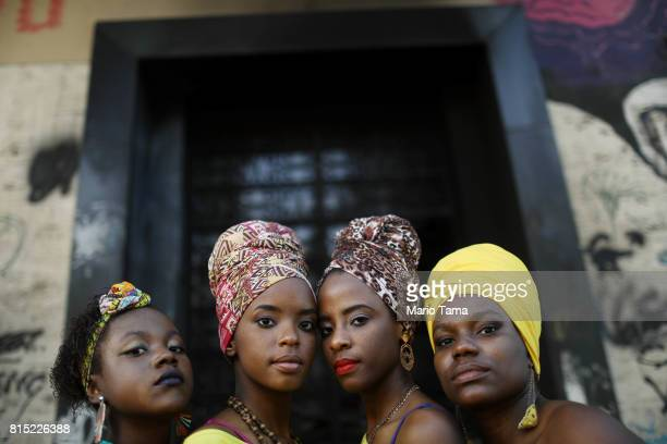 Dancers from the group Lemi Ayo pose at an AfroBrazilian festival held next to the Valongo slave wharf entry point in the Americas for nearly one...