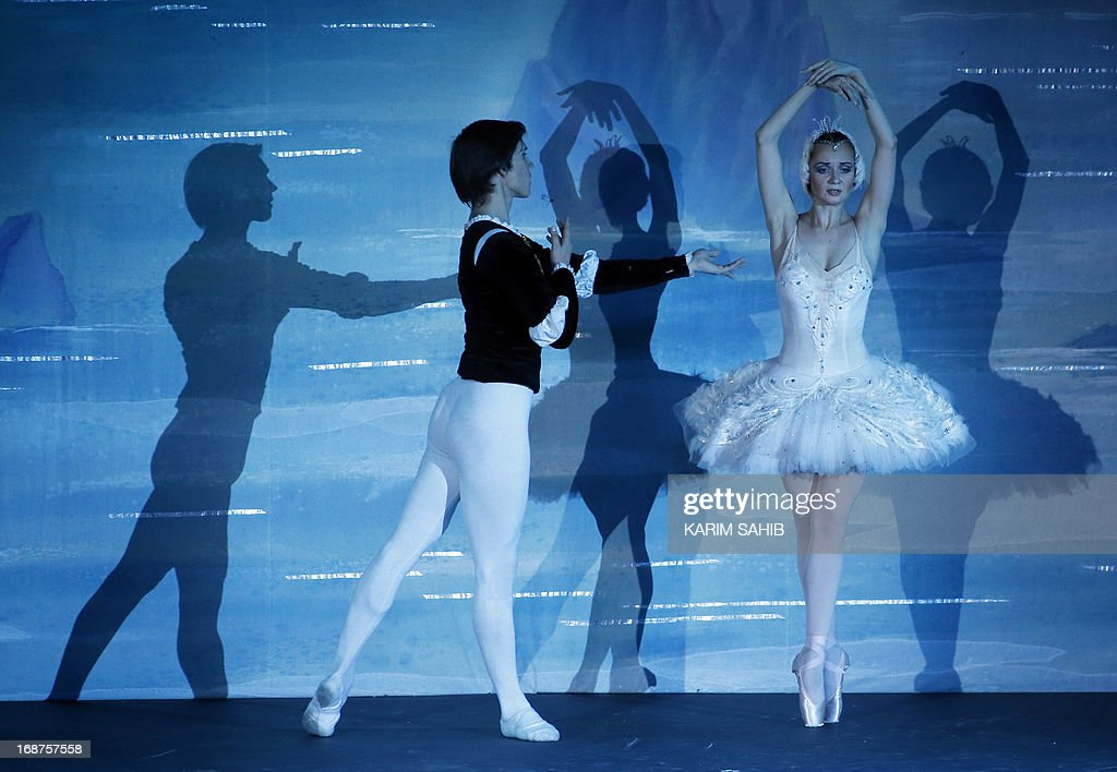 Dancers from the Moscow Royal Ballet, accompanied by Royal Moscow Orchestra, perform Pyotr Ilyich Tchaikovsky's 'Swan Lake' at a theater in the World Trade Center in Dubai, on May 14, 2012, on the last evening of four performance. AFP PHOTO/KARIM SAHIB