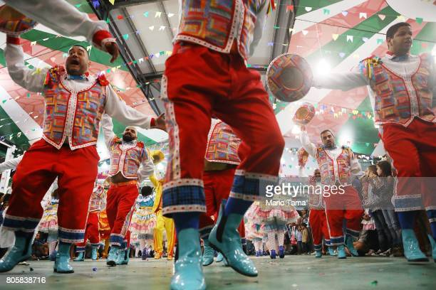 Dancers from the Quadrilha do Sampaio perform during a traditional Festas Juninas party at the Mangueira samba school located in the Mangueira favela...