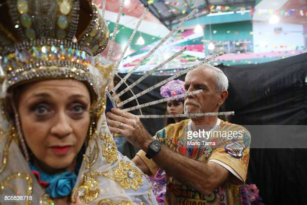 Dancers from the Quadrilha do Sampaio prepare to perform during a traditional Festas Juninas party at the Mangueira samba school located in the...