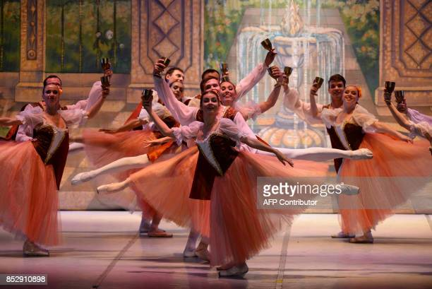 Dancers from the Royal Russian Ballet group perform 'Swan Lake' at the Siri Fort auditorium in the Indian capital New Delhi on September 24 2017 The...