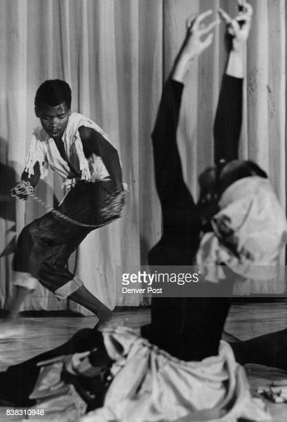 Dancers Highlight Black Unity Program Dennis Thomas of 2575 Locust St a member of the InterCenter Cultural Dancers tries to break chains symbolic of...