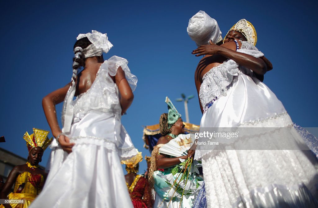 Dancers hug and gather during Carnival celebrations at the Rio Maracatu 'bloco', or street parade, on February 9, 2016 in Rio de Janeiro, Brazil. Festivities have continued throughout major Brazilian cities for Carnival in spite of the threat of the Zika virus. Today is the last official day of Carnival.