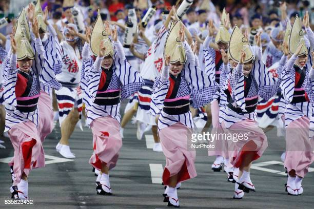 Dancers in colorful costumes perform the traditional Awa Odori folk dance on August 15 2017 in Tokushima Prefecture western Japan Tokushima City's...
