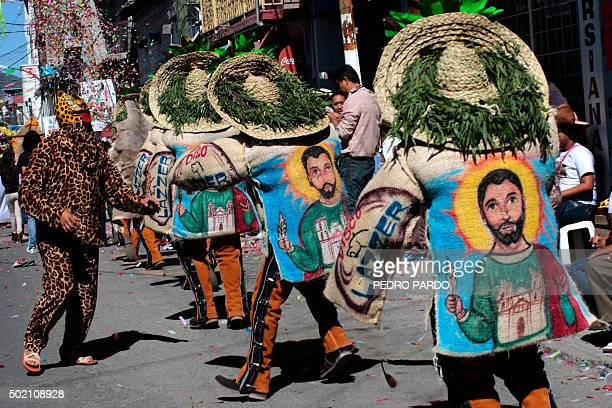 Dancers in costume participate in a traditional Christmas and New Year parade in Chilpancingo Guerrero state Mexico on December 20 2015 AFP PHOTO/...