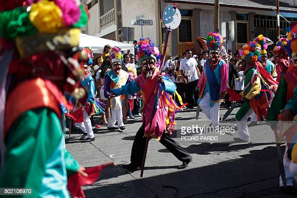 TOPSHOT Dancers in costume participate in a traditional Christmas and New Year parade in Chilpancingo Guerrero state Mexico on December 20 2015 / AFP...