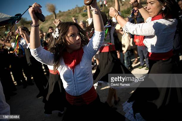 Dancers in traditional costume perform with castanets during a rehearsal before performing in a traditional Verdiales Flamenco contest on December 28...