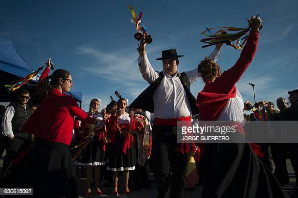 Dancers in traditional costumes perform with castanets during a rehearsal before taking part in a traditional Verdiales Flamenco contest in Malaga on...