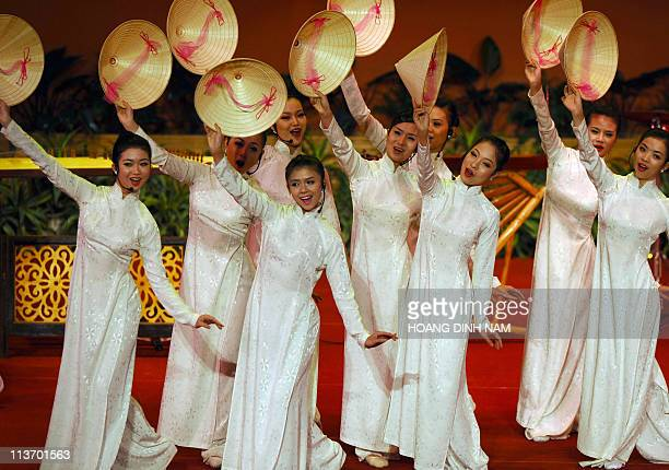 Dancers in traditional dress 'ao dai' perform with conical hats during the opening session of the ADB's 44th annual meeting in Hanoi on May 5 2011...