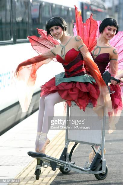 Dancers Isabella Gasparini and Julle Charlet from the Northern Ballet dance beside a train at Waverley Station in Edinburgh to promote their...