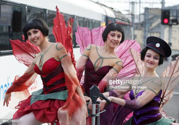 Dancers Isabella Gasparini Julle Charlet and Dreda Blow from the Northern Ballet dance beside a train at Waverley Station in Edinburgh to promote...