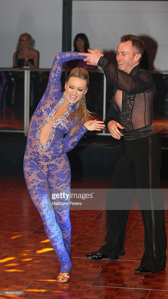Dancers James Jordan and <a gi-track='captionPersonalityLinkClicked' href=/galleries/search?phrase=Ola+Jordan&family=editorial&specificpeople=4958189 ng-click='$event.stopPropagation()'>Ola Jordan</a> perform a ballroom dancing routine as part of Dancing with United, in aid of the Manchester United Foundation, at Old Trafford on March 7, 2013 in Manchester, England.
