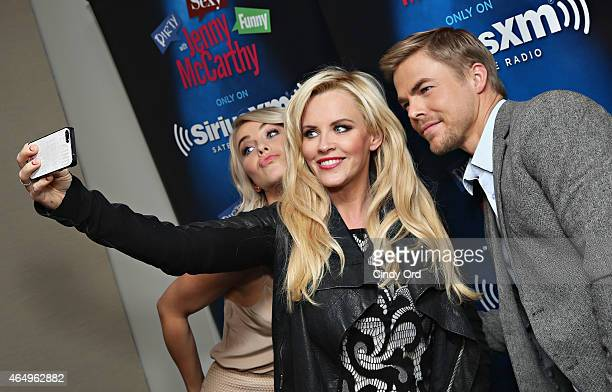 Dancers Julianne Hough and Derek Hough pose for a selfie with host Jenny McCarthy during a visit to 'Dirty Sexy Funny with Jenny McCarthy' at the...