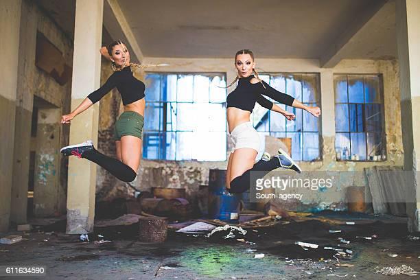 Dancers jump together