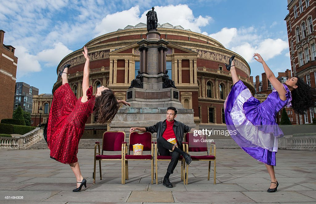 Dancers leap in the air outside the Royal Albert Hall as the venue gears up for 'West Side Story-Film With Live Orchestra' on June 30, 2014 in London, England. West Side Story, the classic film accompanied by the Royal Philharmonic Concert Orchestra playing live on stage runs between Friday 4th July to Sunday 6th July with 25,000 Shark and Jet fans descending on the iconic venue.