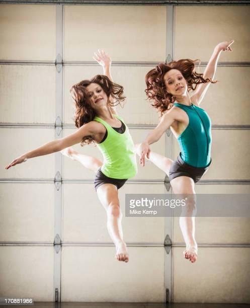Dancers leaping in studio