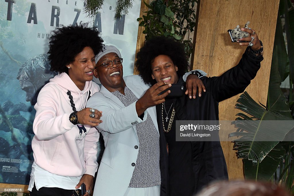 Dancers Les Twins pose for a selfie with actor Samuel L. Jackson (C) at the premiere of Warner Bros. Pictures' 'The Legend of Tarzan' at the Dolby Theatre on June 27, 2016 in Hollywood, California.
